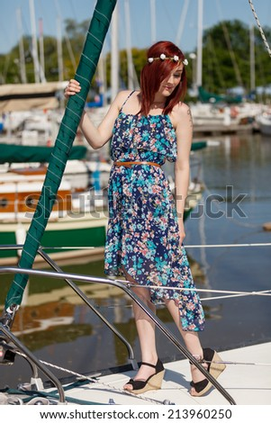An attractive woman on a boat at a marina - stock photo