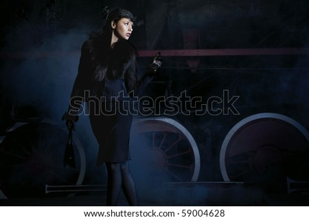 An attractive woman wating on the train - stock photo