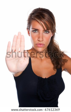 "An attractive woman with a mad stern face holds up her hand as if to say ""stop"" or ""no"""
