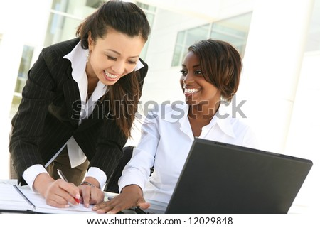 An attractive women business team (Focus on African Woman) - stock photo