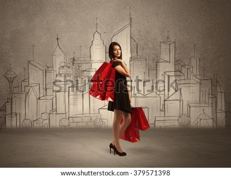 An attractive young lady standing with red shopping bags in front of drawn city landscape silhouette concept - stock photo