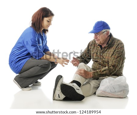 An attractive young volunteer passing out water to an elderly homeless man. On a white background. - stock photo