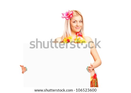 An attractive young woman dressed in a hawaiian costume holding a  panel isolated on white background - stock photo