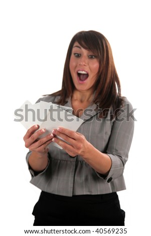 an attractive young woman enjoys her family photo prints, isolated on white, with room for your text - stock photo
