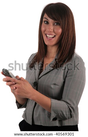 an attractive young woman reads and sends text messages from her phone, isolated on white, with room for your text - stock photo