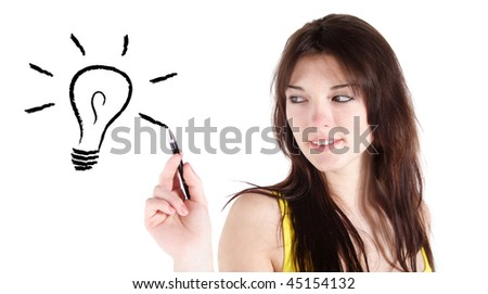 An attractive young woman sketching a stylized light bulb. All isolated on white background.