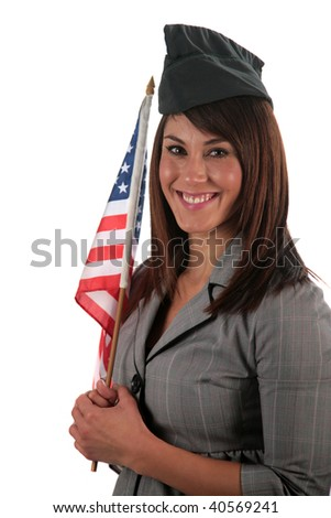 an attractive young woman smiles as she holds her american flag, isolated on white, with room for your text