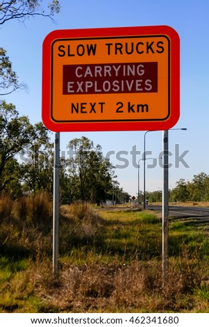 An Australian Road Sign in rural Queensland on the Bruce Highway near Bajool warning drivers of slow trucks carrying explosives in the area, not a common road sign!