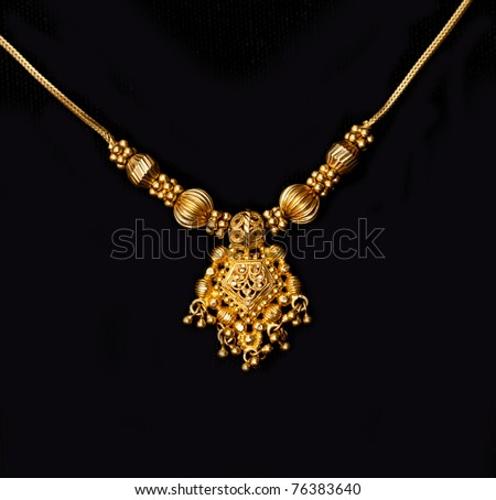 an authentic indian jewellery isolated on black background - stock photo