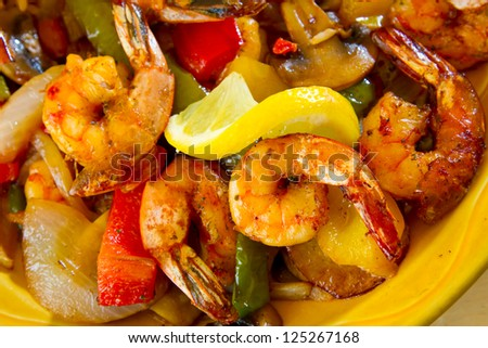 An authentic Mexican food restaurant has plated fajitas ready to serve. - stock photo