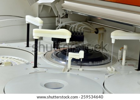 An automated analyzer is a medical laboratory instrument designed to measure different chemicals and other - stock photo
