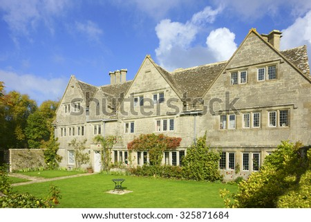 An Autumn view of a Cotswold country Mansion and gardens in The Cotswolds, Gloucestershire, United Kingdom