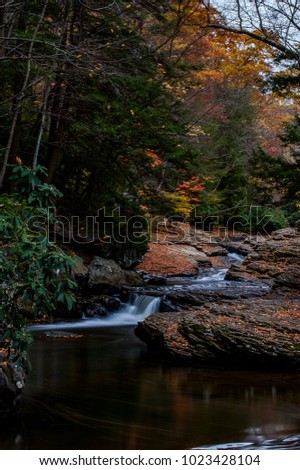 An autumn view of an unnamed cascade in the hills and mountains of New York.