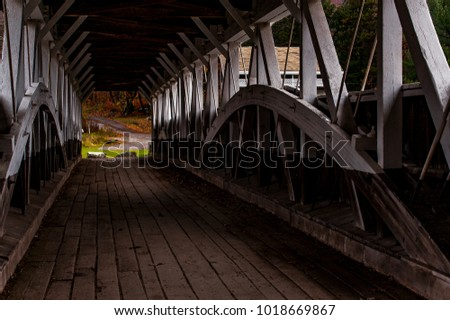 An autumn view of the historic Barronvale Burr arch truss covered bridge in Somerset County, Pennsylvania.