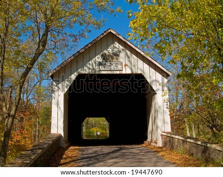 An Autumn view of the historic Sheards Mill Covered Bridge located in Bucks County, Pennsylvania. - stock photo