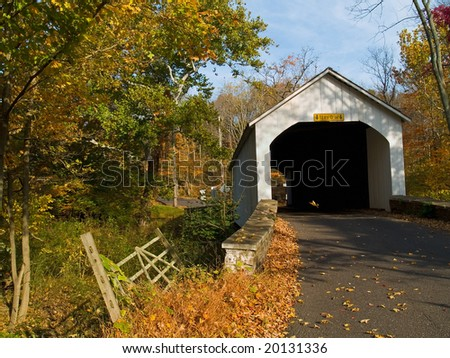 An Autumn  view of the Loux Covered Bridge located in Plumstead Township, Bucks County, Pa. - stock photo