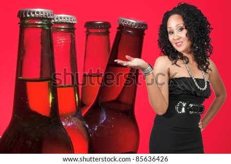 An beautiful black woman with the adult beverage known as beer - stock photo
