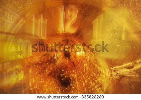 An close up motion blurred abstract of a gold plated clock. - stock photo
