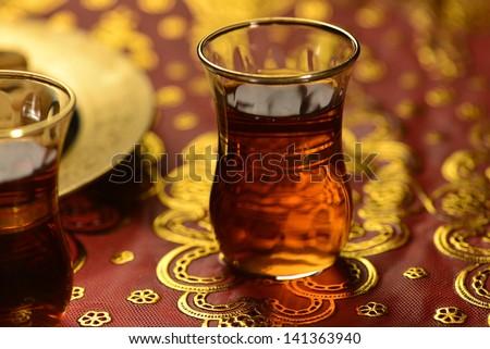 An close up of an islamic tea cup - blur treatment - stock photo