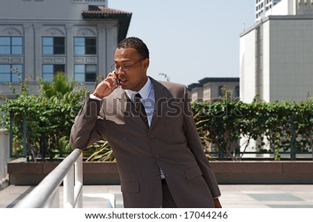 An confident and successful African-American businessman in a power suit - stock photo