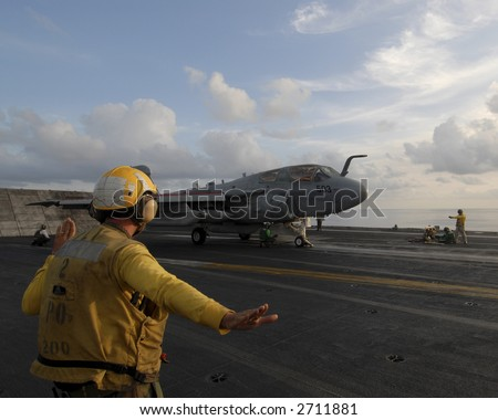 An EA-6B Prowler readies to launch from an aircraft carrier - stock photo