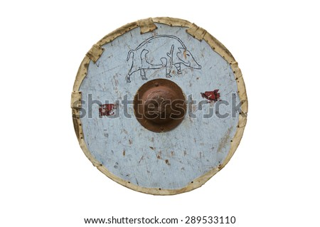 An early medieval round wooden shield, edged in leather with an Iron central boss. - stock photo