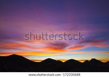 An early morning sunrise over the mountains in Arizona - stock photo
