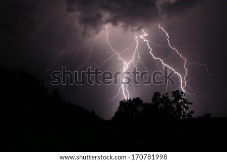 An early summer thunder and lightning display - stock photo