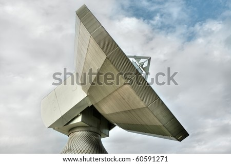 An earth station satellite installation with ancillary building - the type used for broadcasting. - stock photo