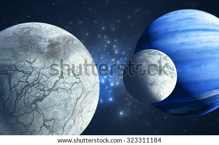 An Earthlike moon and icy moon orbiting a gas giant host planet - stock photo