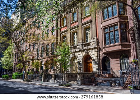An East side of Manhattan street on a sunny Spring afternoon. - stock photo