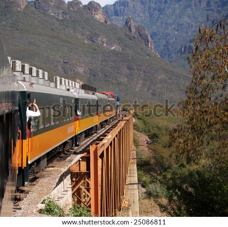 An eastbound Mexican passenger train winds its way up the Copper Canyon, climbing 6500' in a matter of 150 miles - stock photo