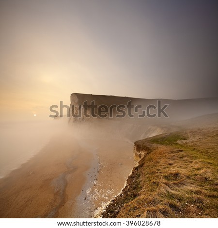 An eerie sea mist rolls in over Bat's Head on Dorset's fabulous Jurassic Coast - stock photo
