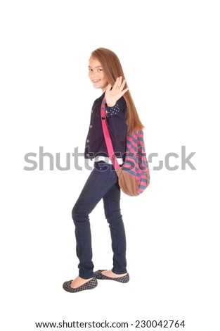 An eight year schoolgirl with her backpack over her shoulder standing for white background, waiving good by.  - stock photo