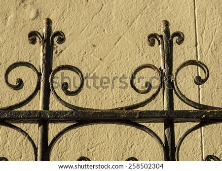 An elaborate wrought iron fence in New Orleans. - stock photo