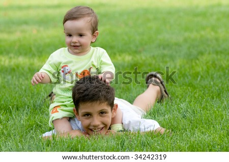 an elder brother is playing with his younger - stock photo