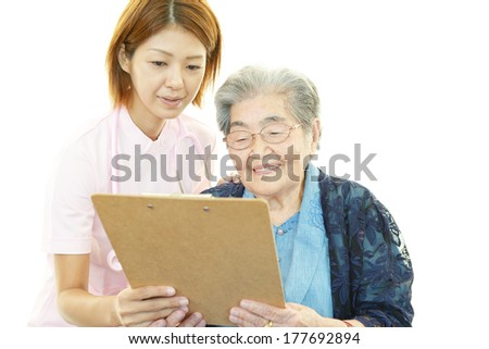 An elderly lady and nurse of the smile - stock photo