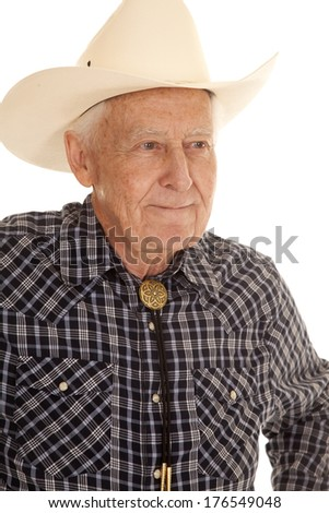 An elderly man in a cowboy hat up close serious. - stock photo