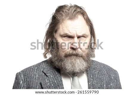 An elderly man in a suit with a demonic look - stock photo