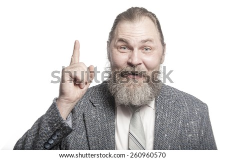 An elderly man in a suit with the index finger