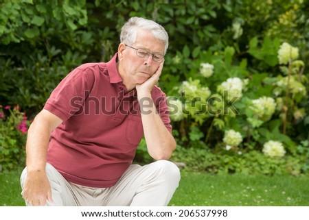 An elderly man is unsatisfied - stock photo