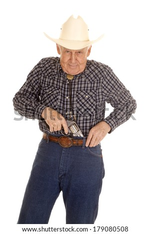 An elderly man puts a pistol in his pants. - stock photo