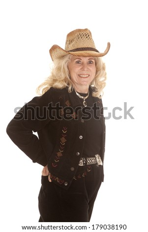 An elderly woman in her cowgirl clothing with a smile on her face.