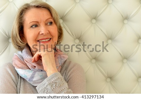 an elderly woman looking away and smiling - stock photo