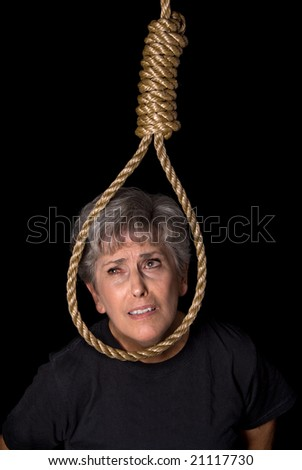 An elderly woman prepares to commit suicide by hanging. - stock photo