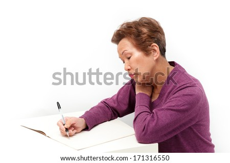 An elderly woman to write a letter