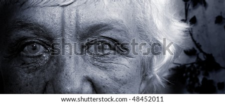 An elderly woman with gray hair. Black and white portrait. Closeup