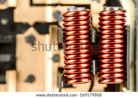 An electrical coil with iron core, detail of the control device used in the automotive industry shown up close - stock photo