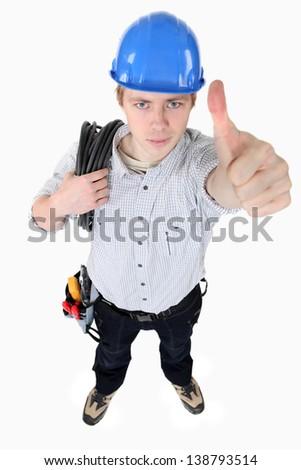An electrician giving the thumb up. - stock photo