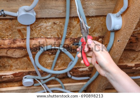 Junction box stock images royalty free images vectors an electrician hand with pliers during install mount light junction box wiring for ceiling sciox Gallery